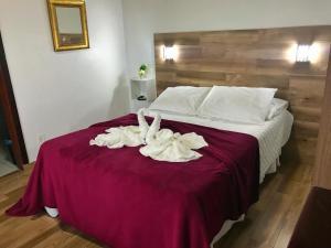 Cama ou camas em um quarto em Hotel Marazul