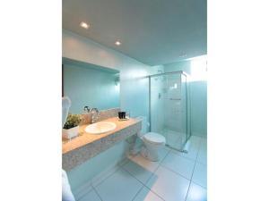 Um banheiro em Hotel Serrano