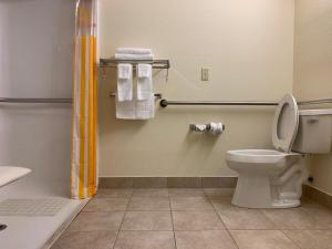 A bathroom at Rincon Inn and Suites