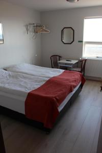 A bed or beds in a room at Sunnuberg Guesthouse