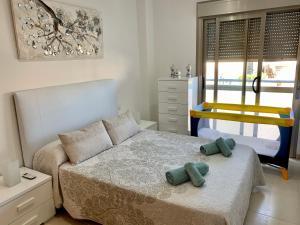 Postel nebo postele na pokoji v ubytování Samsara Beach
