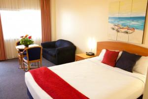 A bed or beds in a room at Karinga Motel, SureStay Hotel by Best Western