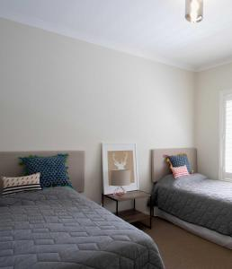 A bed or beds in a room at Gracefield Estate