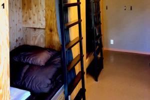 ゲストハウス アンダアモにある二段ベッド