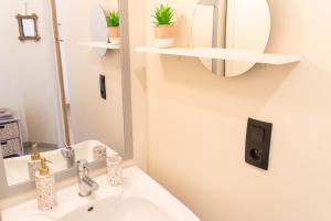 Salle de bains dans l'établissement La Fée Maison