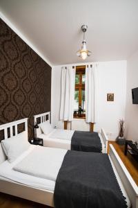 Postel nebo postele na pokoji v ubytování Penzion Kroměříž