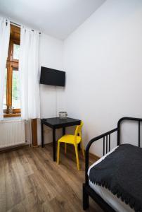 TV a/nebo společenská místnost v ubytování Penzion Kroměříž