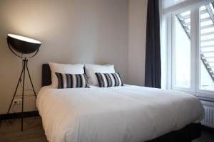 A bed or beds in a room at Dudok Studio's Arnhem