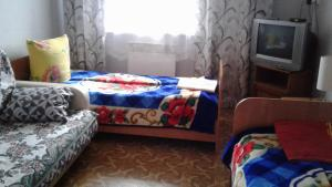 A bed or beds in a room at Guest House Angarskie Khutora