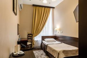 Кровать или кровати в номере М-Отель