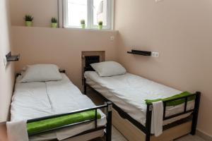 Кровать или кровати в номере SV Хостел