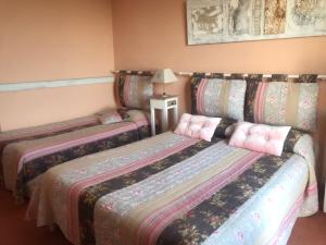 A bed or beds in a room at Les Belles Terrasses