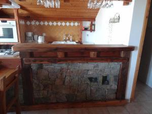 A kitchen or kitchenette at Le Coup de Sabre