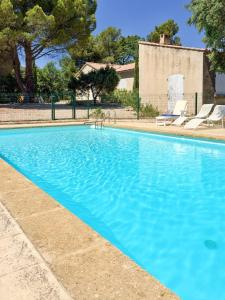 The swimming pool at or near House with 4 bedrooms in Cucuron with private pool furnished garden and WiFi