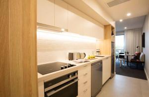 A kitchen or kitchenette at Quest Orange