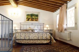 Letto o letti in una camera di Villa Pian De Noci - Tenuta del Palagio