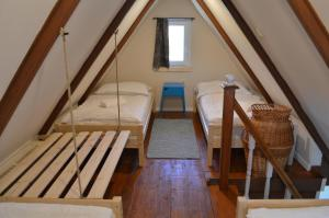 A bed or beds in a room at Intertranscoop Lake House