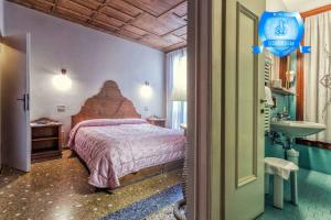A bed or beds in a room at B&b Allegri