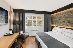 Cama o camas de una habitación en Melia Sierra Nevada