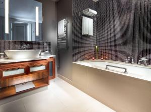 A bathroom at The Grand Mark Prague - The Leading Hotels of the World