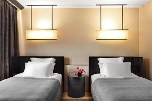 A bed or beds in a room at Bulgari Hotel Milano