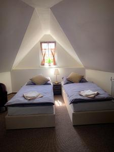 A bed or beds in a room at JP-KU ubytování Kadaň