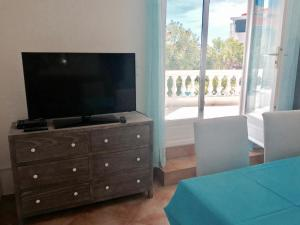 A television and/or entertainment center at Villa Colombier