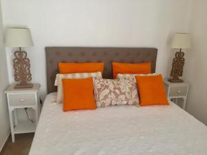 A bed or beds in a room at Villa Colombier