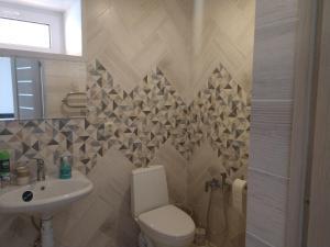 Ванная комната в Золотой скорпион Чагода
