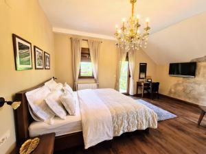 A bed or beds in a room at Zrinka House
