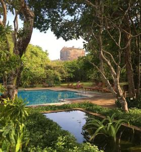 The swimming pool at or near Sigiriya Village
