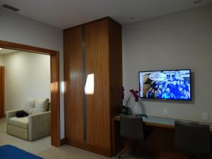 A television and/or entertainment center at Casa do Professor Visitante Unicamp