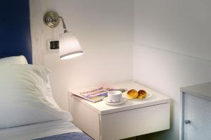 Letto o letti in una camera di B&B Sorrento Central