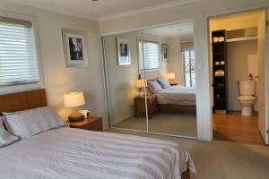 A bed or beds in a room at Boat Harbour Beach Luxury Villa