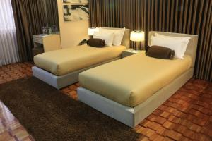 A bed or beds in a room at Prince Plaza II Condotel