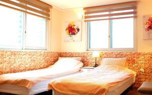 류 게스트하우스 강남 객실 침대