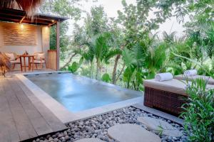 The swimming pool at or near Fivelements Retreat Bali