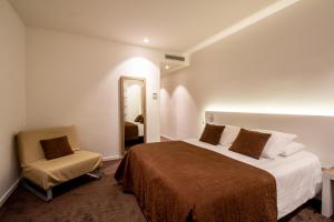 A bed or beds in a room at Best Western Plus Hotel Prince De Galles
