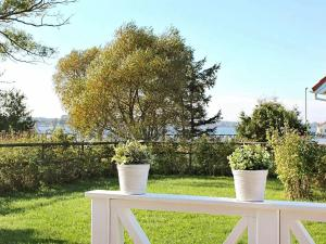 A garden outside Three-Bedroom Holiday home in Gelting 7