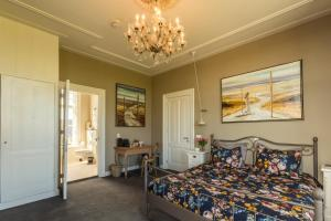 A bed or beds in a room at Pastorie Stella Marie