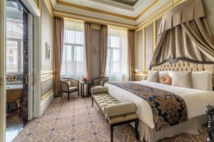Кровать или кровати в номере Лотте отель Санкт-Петербург – The Leading Hotels of the World