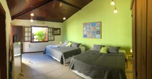 Cama o camas de una habitación en Pousada Caminho do Sol