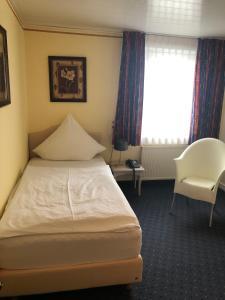 Ein Bett oder Betten in einem Zimmer der Unterkunft Hotel Albus