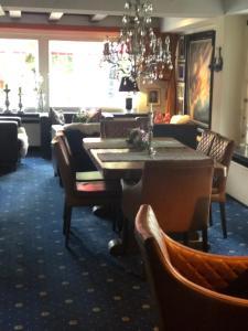 Ein Restaurant oder anderes Speiselokal in der Unterkunft Hotel Albus