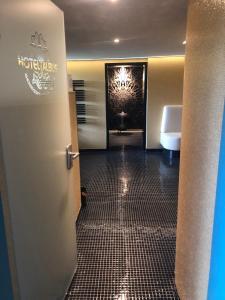 Ein Badezimmer in der Unterkunft Hotel Albus
