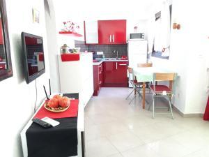 A kitchen or kitchenette at Apartamento Oasis Park