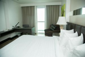 A bed or beds in a room at Mercure Macae