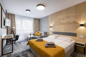 Łóżko lub łóżka w pokoju w obiekcie KRISTINA Willa & Spa