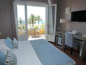 Un ou plusieurs lits dans un hébergement de l'établissement Hotel Espadon