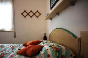 A bed or beds in a room at Azzurro Apartment
